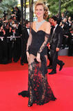 Eva Herzigova shows her legs and cleavage and small reveling black dress at Che premiere during the 61st International Cannes Film Festival