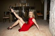 Yvonne Strahovski - on the floor and showing off her long legs
